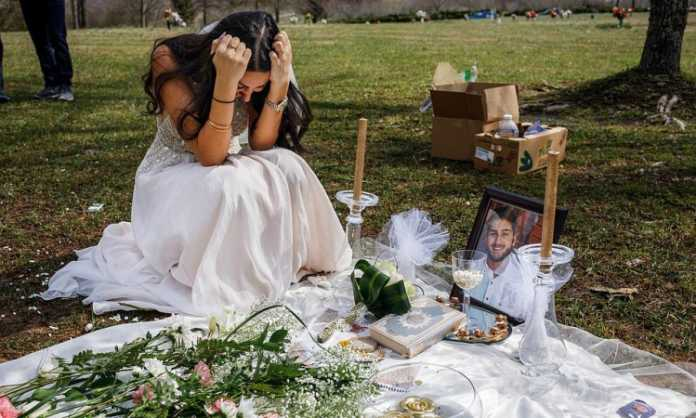 Bride wearing wedding dress during hubby's burial