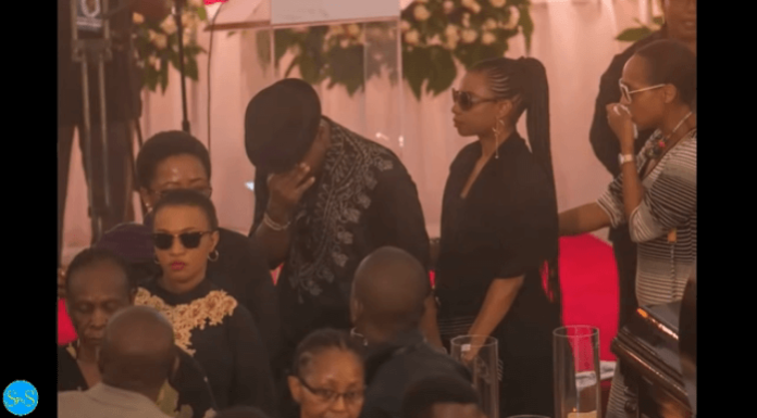 omi 696x385 - Tanzanian celebrities faint, break down during media mogul's burial