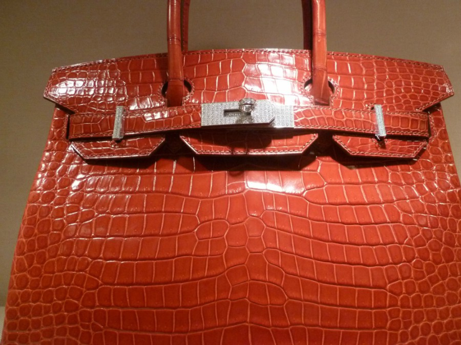 An example of a Crocodile Birkin bag in red.photo credit. Commons Wikimedia - Kim Kardashian goes for law exam carrying Shs. 10 million handbag