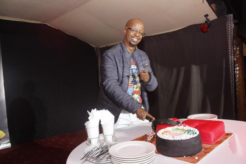 David Mureithi cutting cake assisted by Carnivore CEO Martin Dunford - Pierra Makena, Janet Mbugua party hard at DJ D-Lite's 50th birthday event
