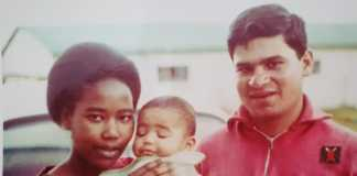 Julie-Gichuru-as-a-toddler-being-held-by-her-father