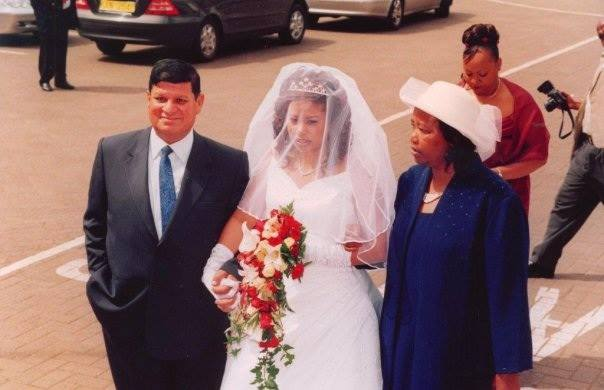 Julie gichuru with her parents on her wedding day - Julie Gichuru reveals photo of parents in mother's day TBT