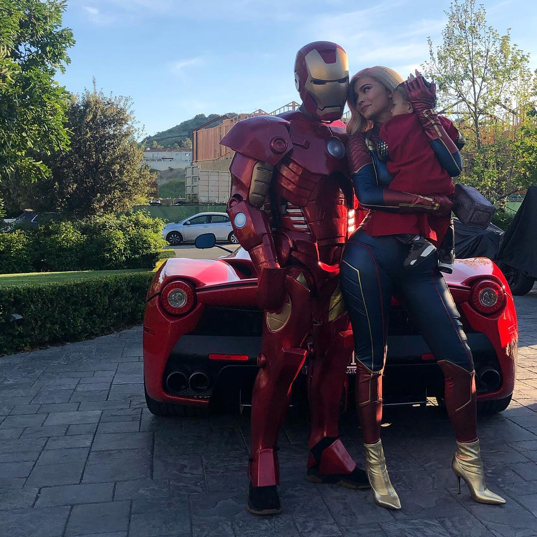Kylie Jenner and Travis Scott wearing superhero suits 1 - Kylie Jenner asks Travis Scott for another baby