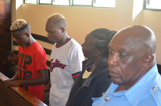 Murder suspects Joseph Ochieng Robert Namukollo and Mary Amollo in a Muranga court on May 17 image ALICE WAITHERA - Don't dare take my DNA! Murdered prison warder's Facebook date tells court