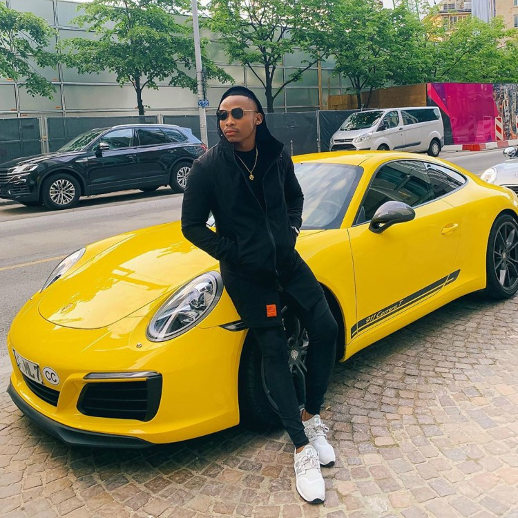 Otile-Brown-posing-with-a-yellow-Porshe