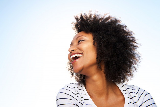 cheerful young black woman laughing outdoors against bright sky 33839 11588 - Married sponsor speaks out, 'There are things I share with her alone'