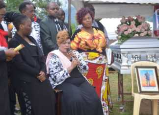 Prophetess Betty Kadori of Zion Fire Anointing Church in Mombasa addressing mourners who attended the burial of her slain son David Stewart in Taita Taveta County.