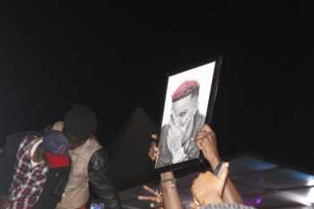 Fans cheer on Jamaican star Konshens as he takes over the stage at the concert hosted at Ngong Race Course