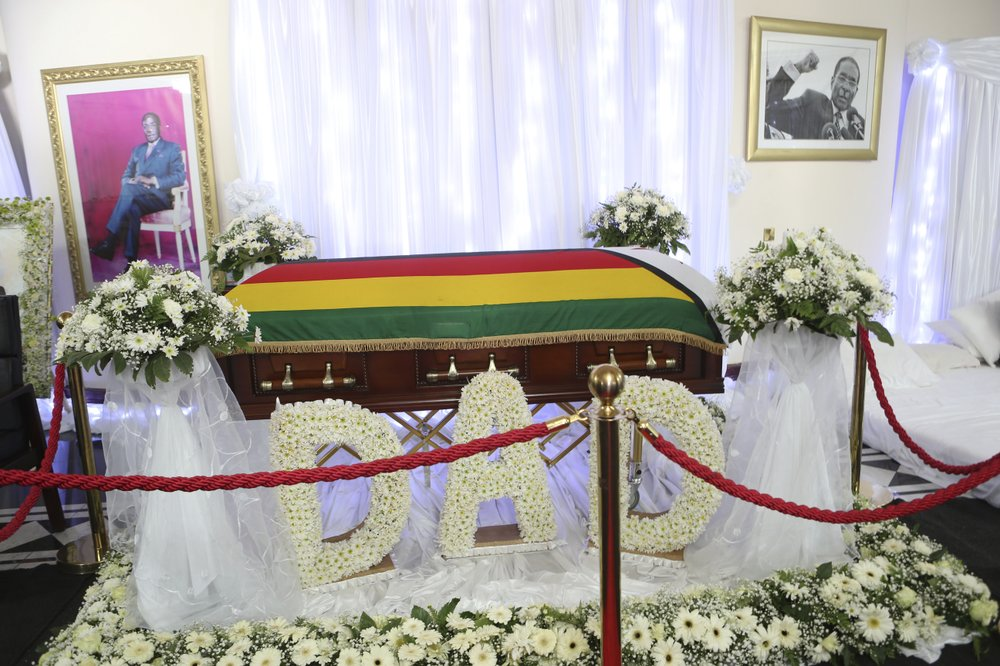 Casket carrying Robert Mugabe's body at his home