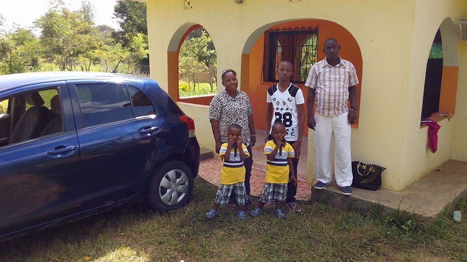 The late John Mutinda and his family outside their home