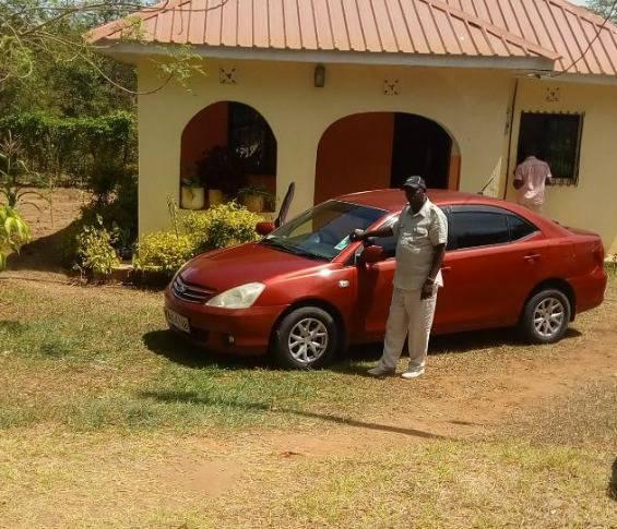 The late John Mutinda besides the car he drove into the Indian ocean meeting his death