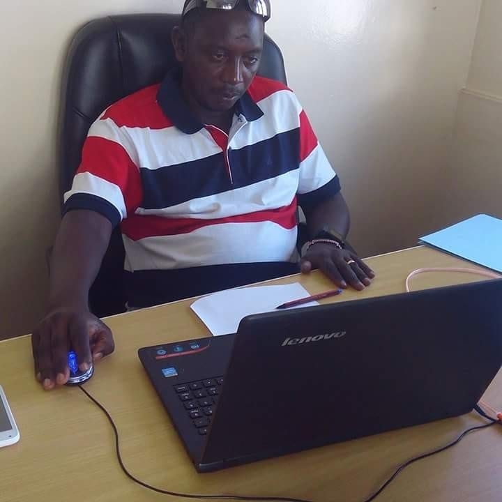 John Mutinda in the office