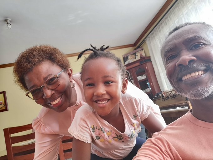 Ian Mbugua with his wife and granddaughter.